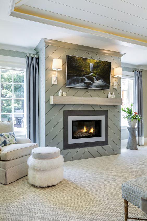 Get creative cover your fireplace with shiplap in soothing color and chevron pattern found on house of turquoise