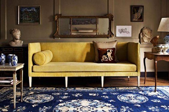 Image from Laurel Bern's blog. Love that this is an otherwise moody dark room, but then this fabulous saturated yellow sofa adds a little life!