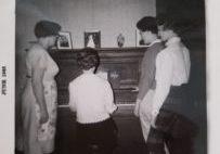 Stewart girls around piano